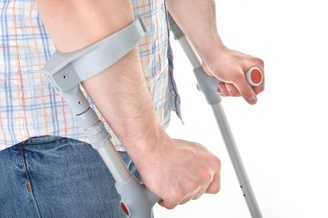 A person's forearms and hands using arm brace crutches