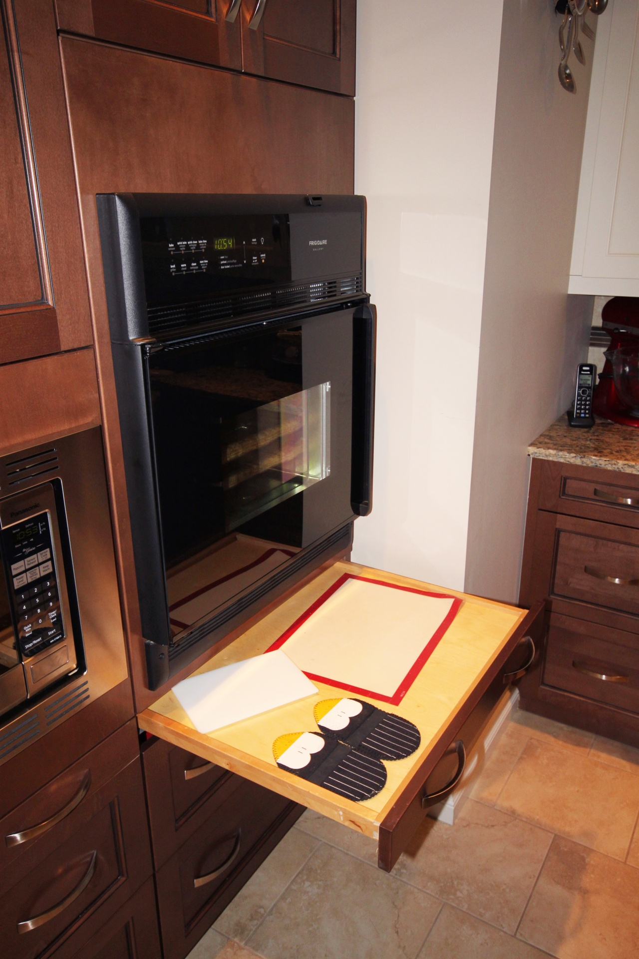 Side-opening stoves and pull-out work surfaces increase accessibility.