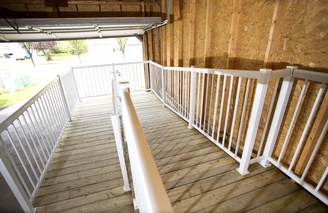 A long ramp with a 180 degree turn, located inside a garage.