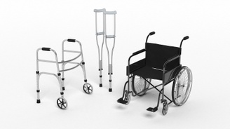 A photograph of a walker, a pair of crutches and a manual wheelchair