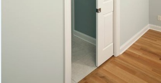 An interior pocket door separates a room from the hallway.