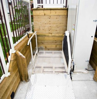 An outdoor residential porch lift is pictured.